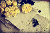 Yellow roses, petals and handmade paper — Stock Photo