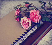 Roses, old books and handmade paper — Stock Photo