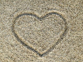 Beautiful sand background with heart — Stock Photo