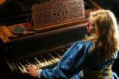 Woman playing on grand piano — Stock Photo