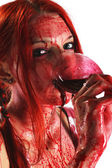 Girl holding glass of blood — Stock Photo