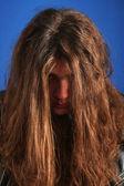 Man showing his long hair — Stock Photo