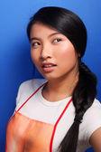 Girl in apron — Stock Photo