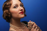Woman with pearl necklace — Stock Photo