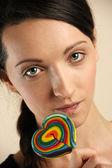 Girl licking lollipop — Stock Photo