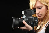 Girl with camera — Stock Photo