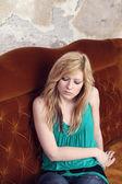 Girl resting on sofa — Stock Photo