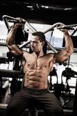 Bodybuilder doing workout — Stock Photo