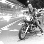 Girl on motorcycle — Stock Photo #43512529
