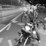 Girl on motorcycle — Stock Photo #43512575