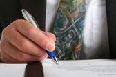 Businessman signing a contract — Stock Photo
