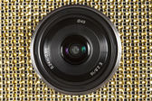 Lens on golden colour pattern. — Foto Stock
