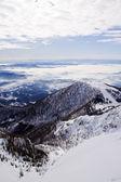 Mountain and a ski slope — Stock Photo