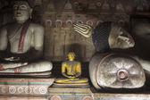 Statues inside Dambula cave temple — Stock Photo