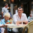 Family in cafe on summer terrace — Stock Photo