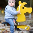 Baby girl having fun on the playground — Stock Photo