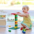 Girl playing with plastic blocks — Stock Photo #42669867