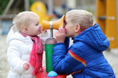 Boy and sister playing together at the playground — Stock Photo