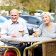Couple of seniors with their granddaughter at the terrace — Stock Photo #42670483