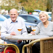 Couple of seniors with their granddaughter at the terrace — Stock Photo