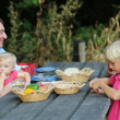 Father with children in the forest having picnic — Stock Photo