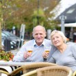 Couple of seniors enjoying glass of cold beer — Foto de Stock