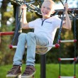 Teenage boy having fun on the sportive playground — Stock Photo