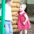 Girl plays with friend in playground — Stock Photo