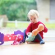 Girl playing with doll — Stock Photo