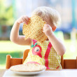Girl eating delicious pancakes — Stock Photo #42670947