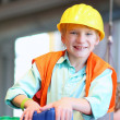 Boy building a house with big plastic construction bricks — Stock Photo #42671173