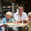 Father with three children having fun in cafe — Stock Photo