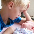 Brother with his newborn baby sister — Stock Photo