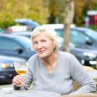 Woman in cafe drinking cold fresh beer — Stock Photo