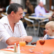 Father and his daughter in Italian cafe — Stock Photo