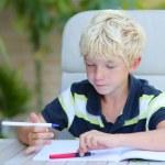 Boy studying home task — Stock Photo