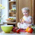 Girl eating tasty paprika — Stock Photo #42672155