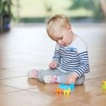 Baby girl play with plastic bricks — Stock Photo #42672183