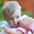 Baby girl holding a baby doll — Stock Photo #42672243