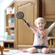 Girl playing with ladle and skimmer — Stock Photo #42672461