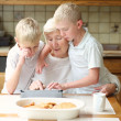 Brothers teaching grandmother to play on tablet pc — Stock Photo