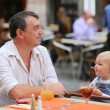 Father and his daughter having fun in Italian cafe — Stock Photo