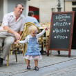 Father and his daughter having fun together in Italian cafe — Stock Photo #42673017