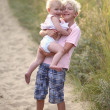 Brother with his baby sister on the beach — Stock Photo #42673089