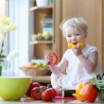 Girl eating tasty paprika — Stock Photo #42673205