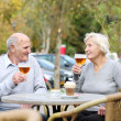 Couple of seniors enjoying glass of cold beer — Photo