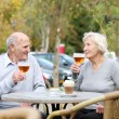 Couple of seniors enjoying glass of cold beer — Foto Stock