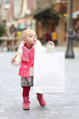 Girl arrying big shopping bag — Stock Photo