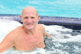 Senior man in the swimming pool — Stock Photo