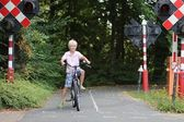 Boy cycling on bike at special training playground — Stock Photo